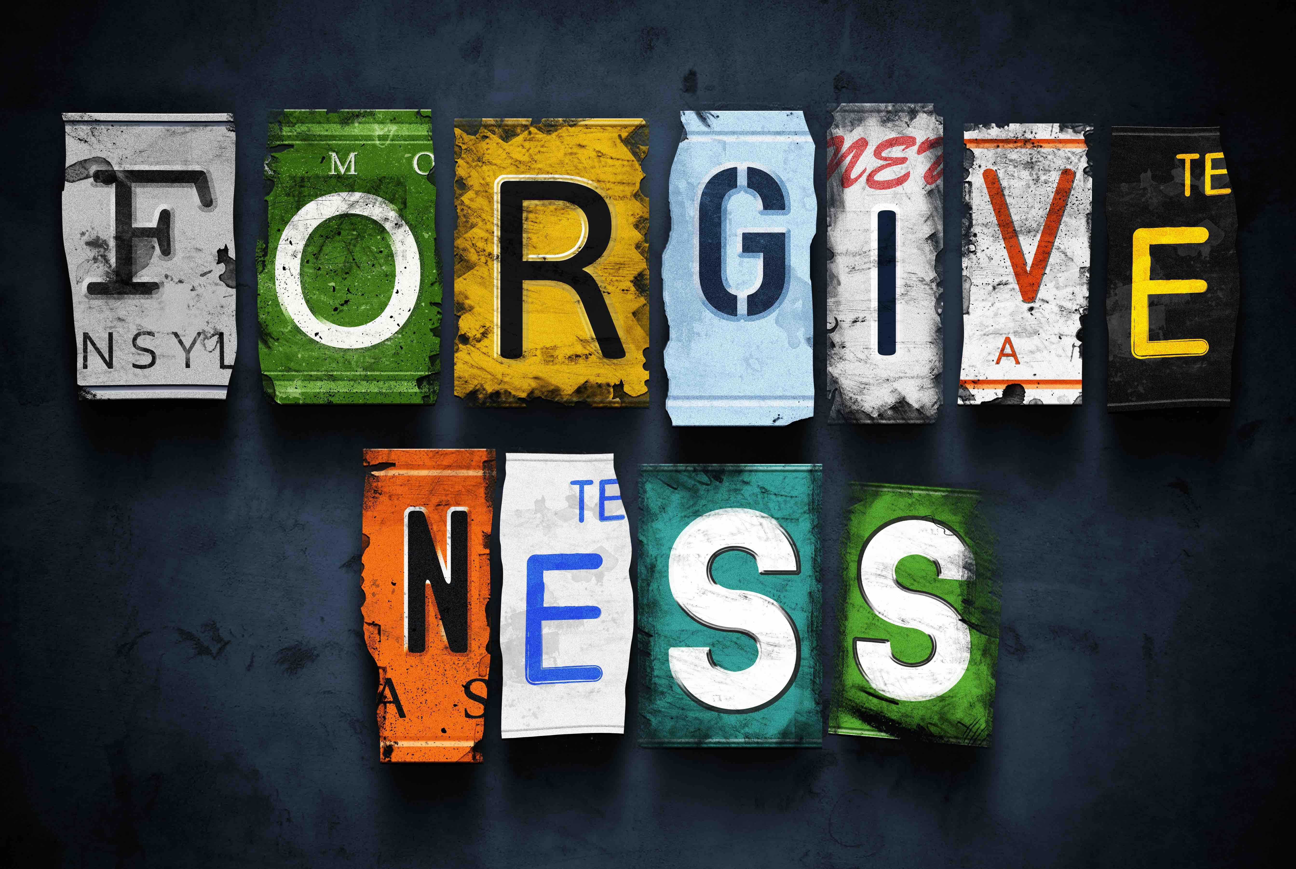 Forgiveness word on vintage broken car license plates, concept sign